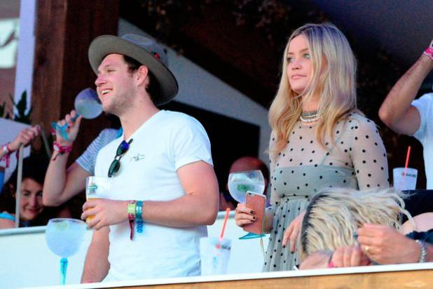 Niall Horan and Laura Whitmore enjoy the atmosphere as they listen to Tom Petty perform as they attend the Barclaycard Exclusive British Summer Time Festival at Hyde Park on July 9, 2017 in London, England. (Photo by Eamonn M. McCormack/Getty Images for Barclaycard)