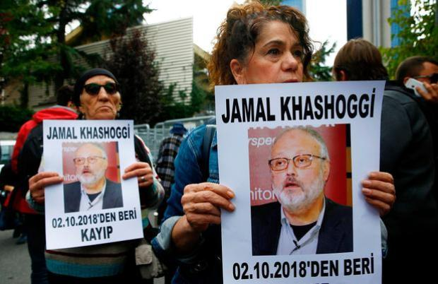 Protest: People hold pictures of Jamal Khashoggi outside the Saudi Consulate in Istanbul. Photo: Reuters