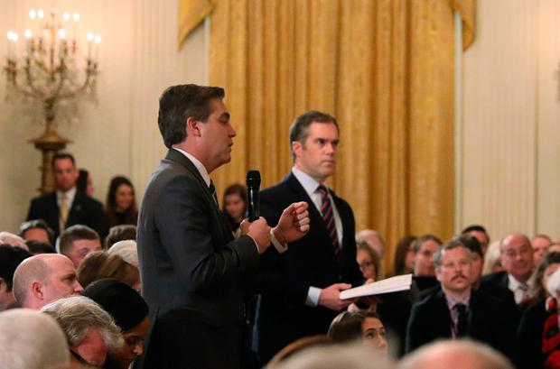 CNN correspondent Jim Acosta questions U.S. President Donald Trump with NBC correspondent Peter Alexander at his side as a White House intern kneels back down in front of them after she tried to take away the microphone held by Acosta during a news conference at the White House in Washington, U.S., November 7, 2018. Picture taken November 7, 2018. REUTERS/Jonathan Ernst