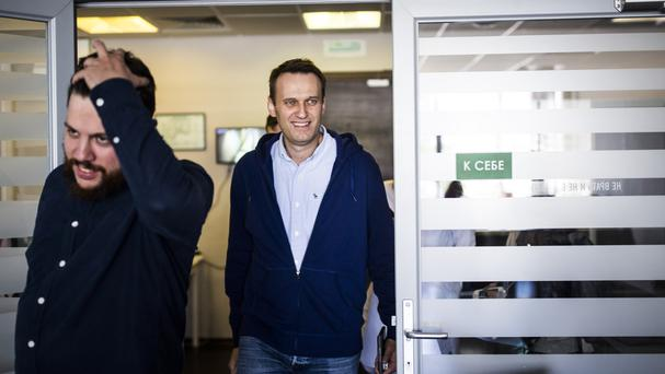 Alexei Navalny, right, arrives at his office in Moscow (AP)