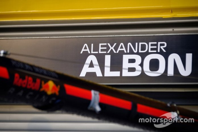 The name of Alex Albon, Red Bull Racing on the garage