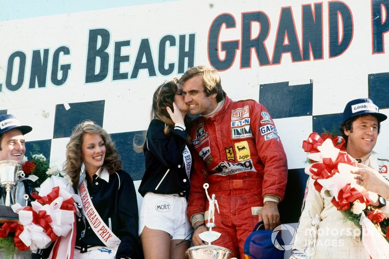 Podiums: Race winner Carlos Reutemann, Ferrari, gets a kiss from Miss Long Beach Grand Prix, second place Mario Andretti, Lotus, third place Patrick Depailler, Tyrrell, at the 1978 United States - West GP