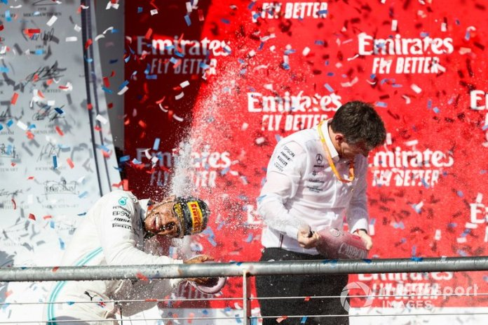 Lewis Hamilton, Mercedes AMG F1, celebrates on the podium with James Allison, Technical Director, Mercedes AMG