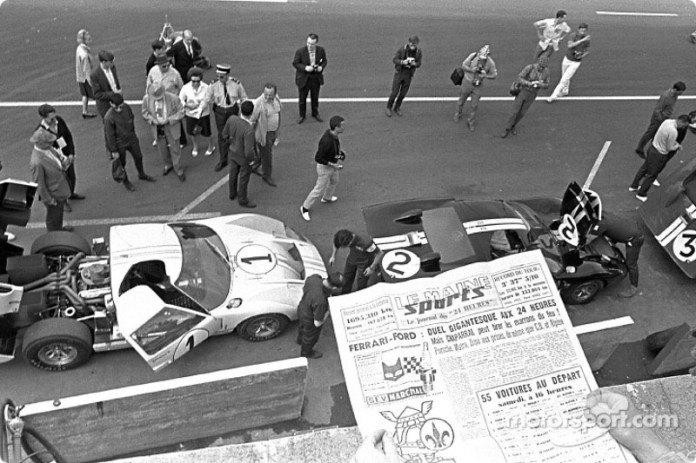 Ford GT-40 team at the Le Mans pits, 1966: Ken Miles and Denny Hulme (1) second; Bruce McLaren and Chris Amon (2) winners; Dick Hutcherson and Ronnie Bucknum (5) finished third