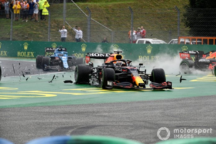 Lando Norris, McLaren MCL35M, Max Verstappen, Red Bull Racing RB16B, and Valtteri Bottas, Mercedes W12, collide at the start