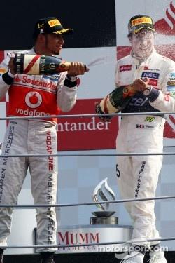 Podium: race winner Lewis Hamilton, McLaren, second place place Sergio Perez, Sauber F1 Team