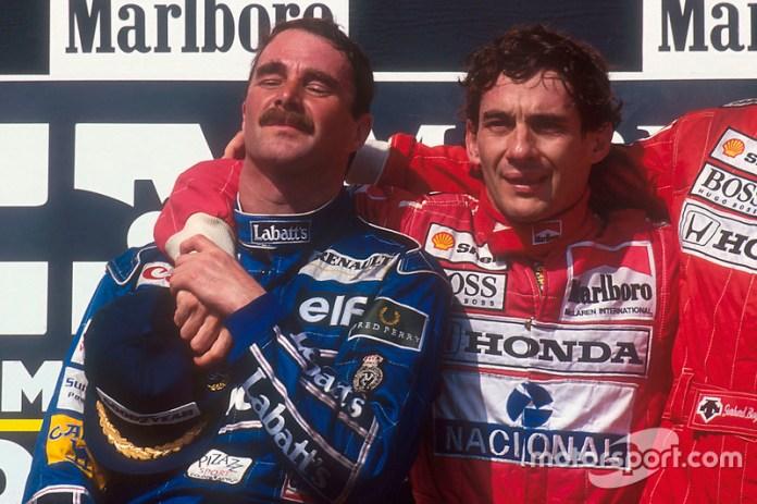 Podio: segundo lugar y nuevo campeón del mundon Nigel Mansell, Williams Renault, ganador de la carrera Ayrton Senna, Mclaren Honda