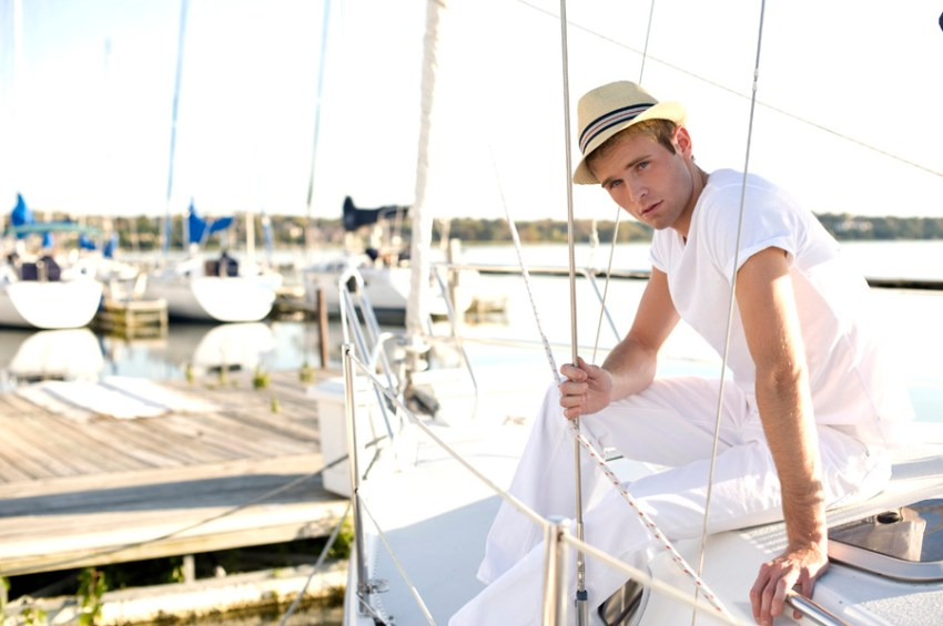 Photo of a man on a sailboat, at a marina, shot with the AF-S NIKKOR 50mm f/1.4G lens