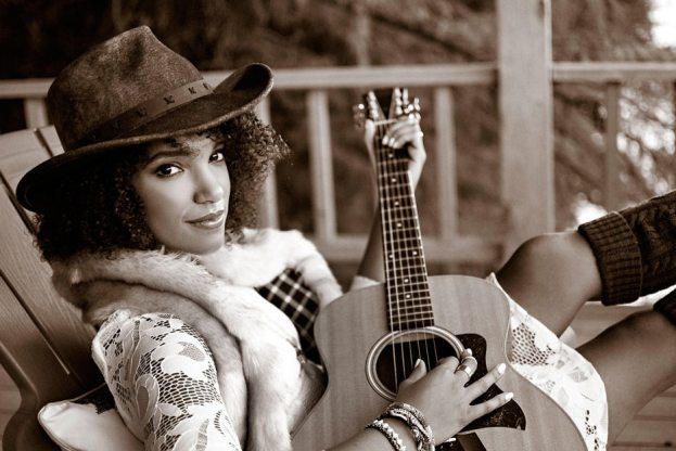 AF-S DX NIKKOR 35mm F/1.8G photo of a woman playing a guitar, in sepia tone
