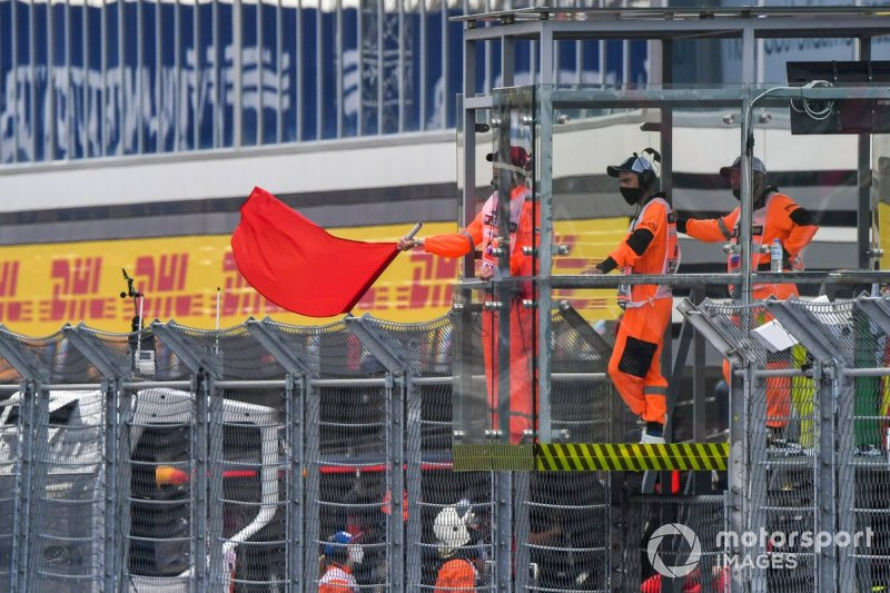 Marshals wave the red flag
