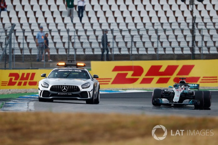 A safety car leads Lewis Hamilton, Mercedes AMG F1 W09