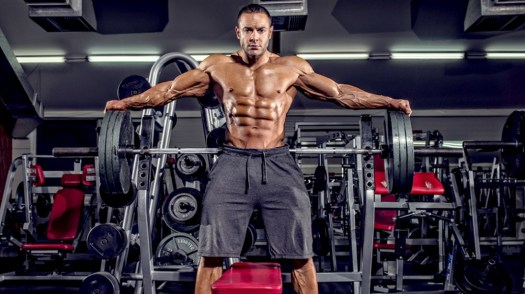 Male-Bodybuilder-Standing-Bench-Barbell