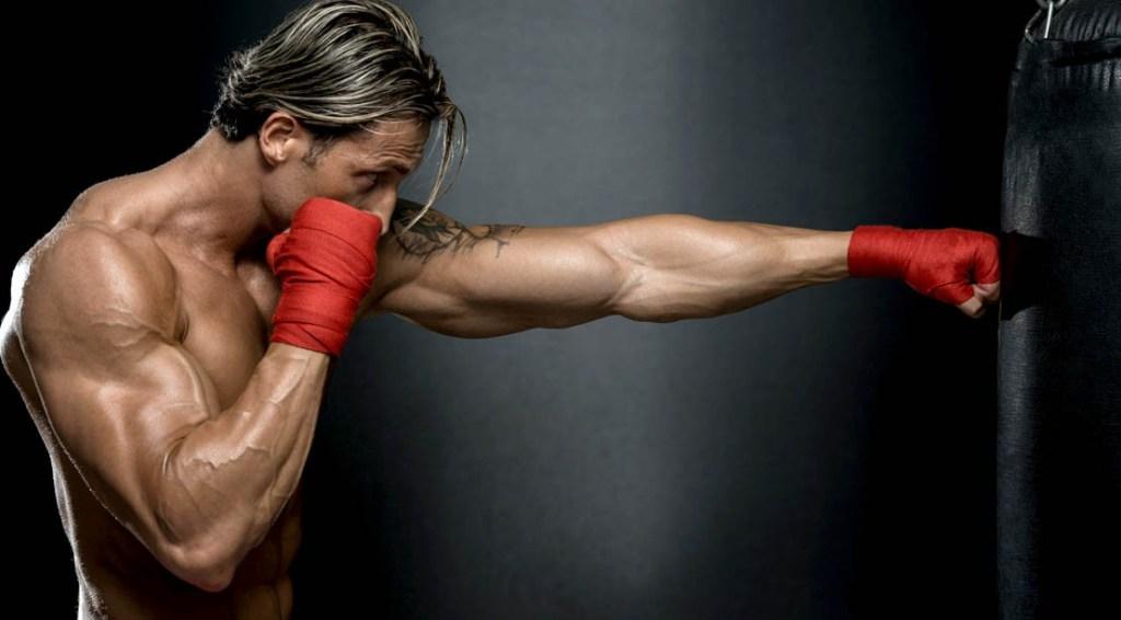 Muscular-Boxer-Punching-Heavy-Bag
