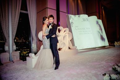 Bride Rosalia and Roy posting for photos at the Four Season hotel Banquet hall