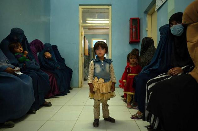 A child standing in a waiting room at the Tangi Saidan clinic.