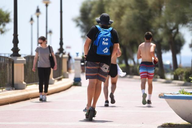 Scooting away among joggers and pedestrians on the Sliema promenade. Photo:Chris Sant Fournier