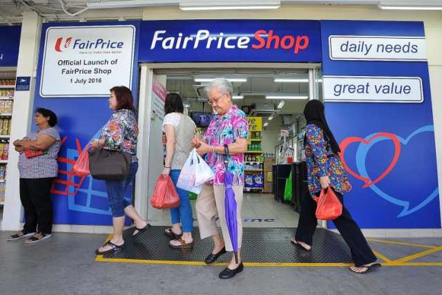 Entrance of FairPrice Shop with customers