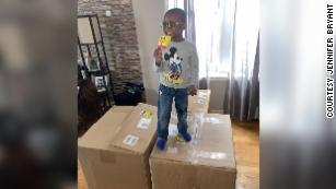 Noah Ruiz enjoys a SpongeBob Popsicle, one of 918 he ordered with his mother's Amazon account.