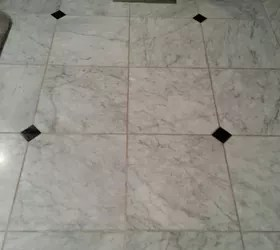 to clean grout on a honed marble floor