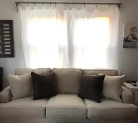 rustic curtain rod corbels with sheet
