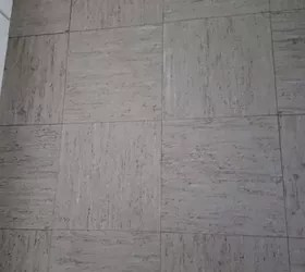 ugly fake tile floors throughout rental