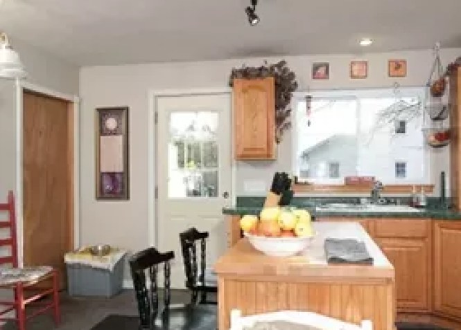Wood Cabinets And Green Countertops