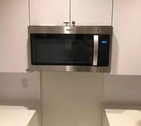 handyman hung microwave on drywall