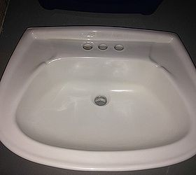 an etched chipped porcelain sink back