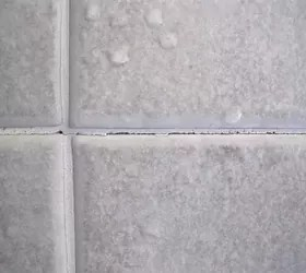 repair cracked grout on shower walls