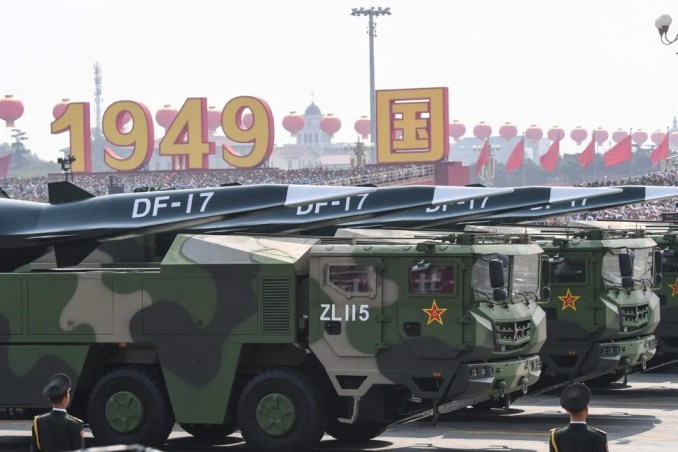 Military vehicles carrying DF-17 missiles take part in China's National Day parade in Beijing. Photo: AFP