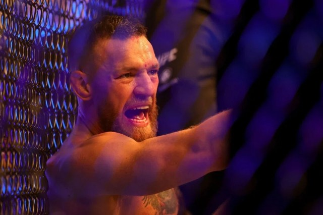 Conor McGregor shouts as he sits on the mat after injuring his leg against Dustin Poirier. Photo: AFP