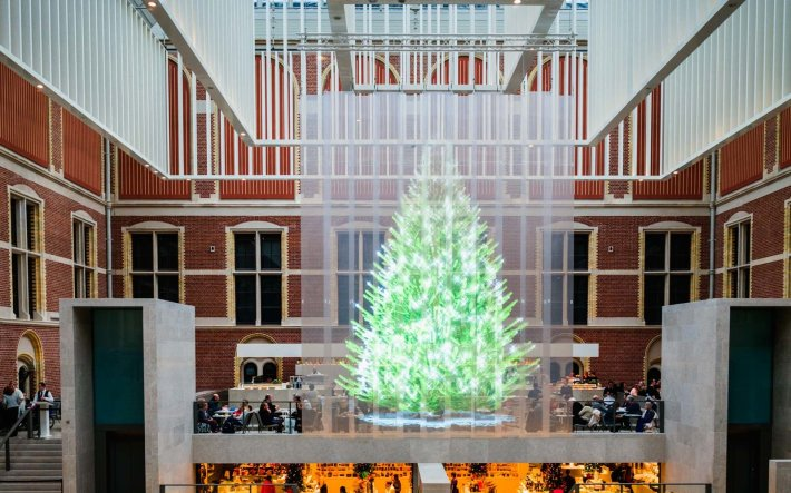 The Holographic Christmas Tree in Amsterdam,  Netherlands | Not all Christmas trees are glittering, light-filled pines. Some are made of chainsaws or sand. Others are towering collections of skis and tumbleweeds. Read on for the world's strangest Christmas trees.