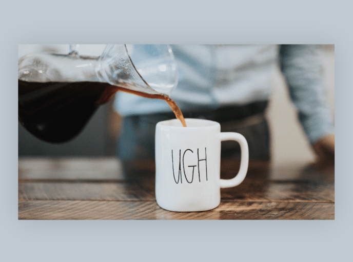 "Image of a person serving coffee in a mug with the word ""ugh"" printed on it"
