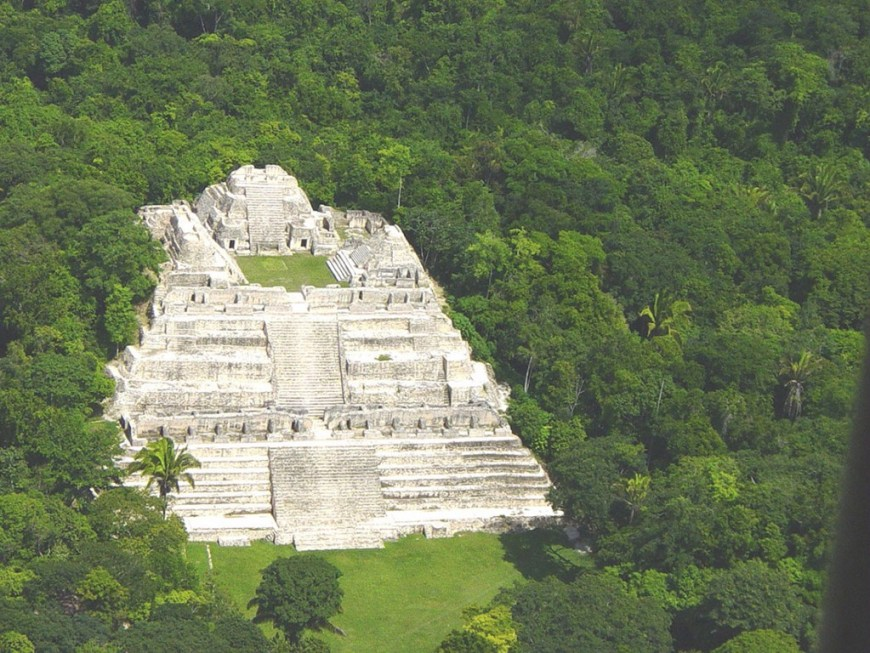 Central and South American Ruins Image: An aerial view of one of the ancient city's prominent structures. It appears to be placed in the middle of the jungle, apart from some of the other city structures.