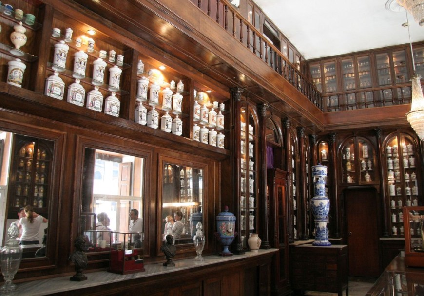 Cuba Unusual Museum Image: The apothecary has well polished wooden built-ins, and lovely lidded jars in different shapes and sizes linking the shelves.