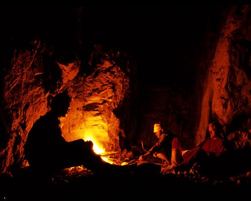 Tribespeople telling tales around the fire