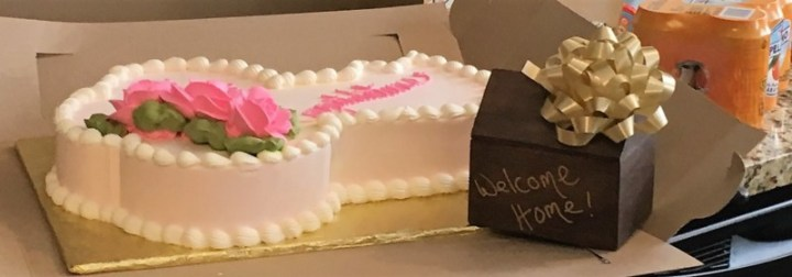 Welcome home gift and cake for the home buyers
