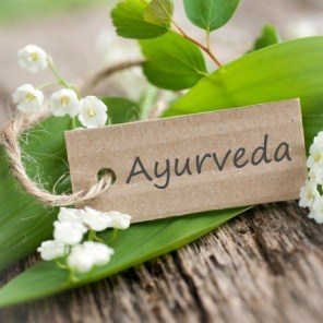 "The word ""Ayurveda"" on a little piece of wood."