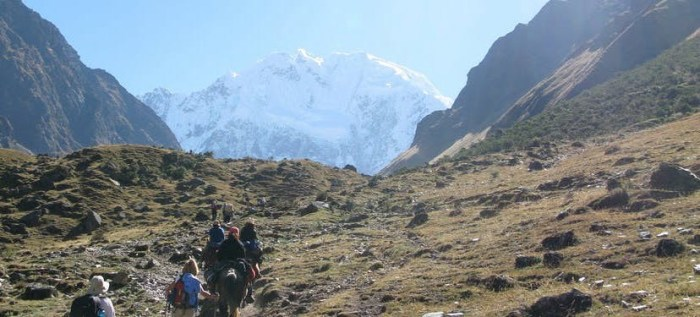 Best Hikes In Peru Image: A group of hikers is pictured making their long trek—there is so much land ahead of them.