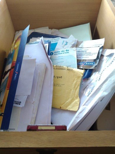Box of unorganized and onmanaged documents and papers
