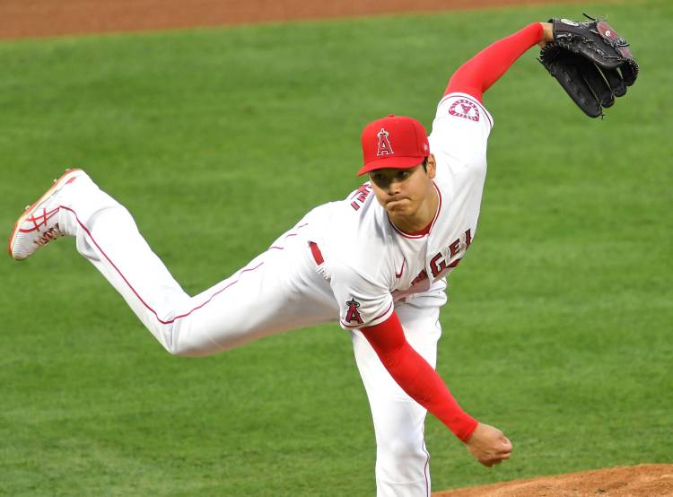 Shohei Ohtani pitches, homers in Angels' victory over ...
