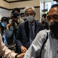 Martin Lee (center), founder of the Hong Kong Democratic Party, leaves a court in Hong Kong on Friday after being given a suspended sentence.  | BLOOMBERG