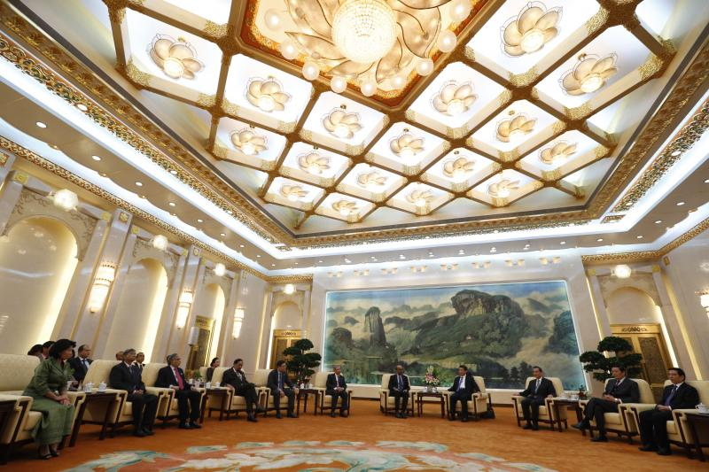 Xi hosts guests at the launch of the Asian Infrastructure Investment Bank in Beijing, China, October 2014