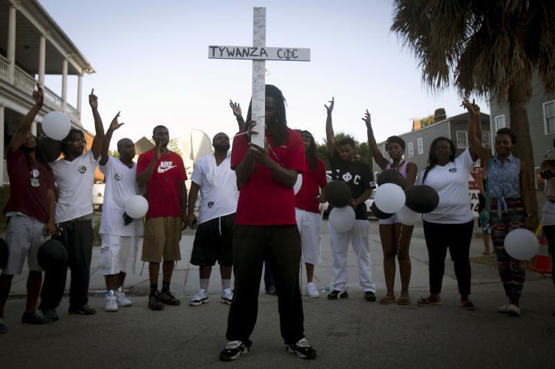 People pray outside Emanuel African Methodist Episcopal Church in Charleston, South Carolina, June 2015.