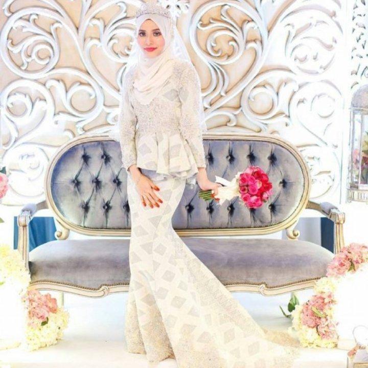 إليك أحدث لفات طرح الزفاف لـالعروس المحجبة بالتاج صور