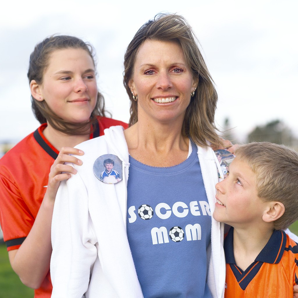 Soccer Mom with Kids --- Image by © Royalty-Free/Corbis
