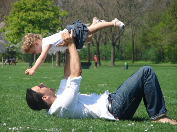 Dad playing with child