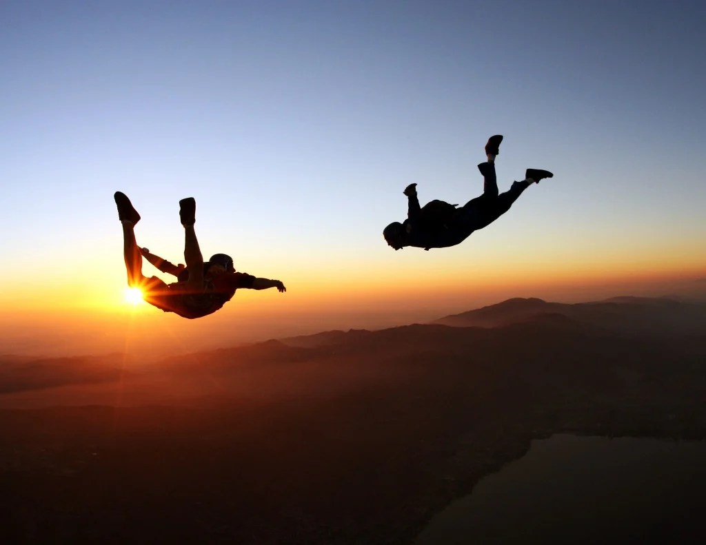 Skydivers jumping at the amazing sunset