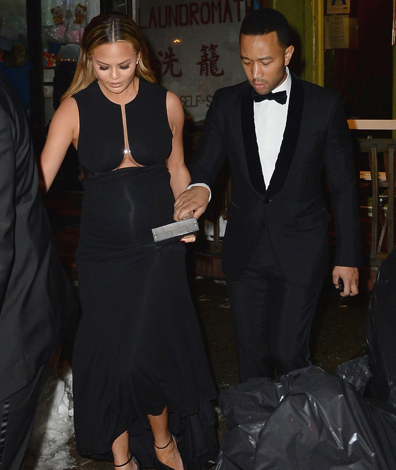 Chrissy Teigen Shows Off Baby Bump In Skin-Tight Gown, As Hubby John Legend Helps Her Through The Snow!