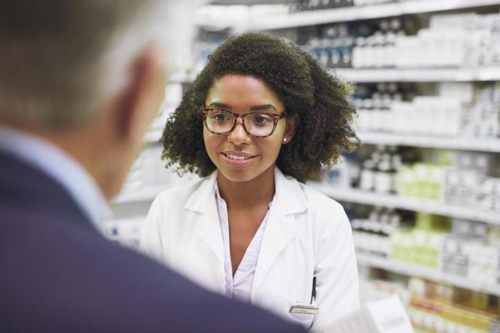 pharmacist speaking with a male customer